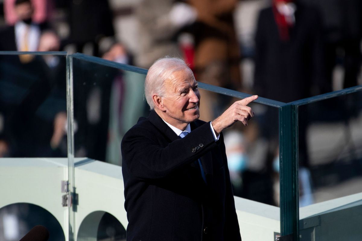 President Joe Biden points to guests attending his inauguration on the West Front of the US Capitol on Wednesday.