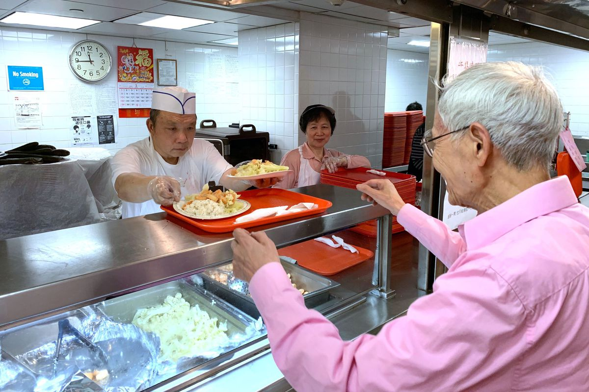 Seniors eat lunch at the Chinese-American Planning Council's Open Door Senior Center, in Manhattan's Chinatown, where attendance has dropped since the coronavirus outbreak.