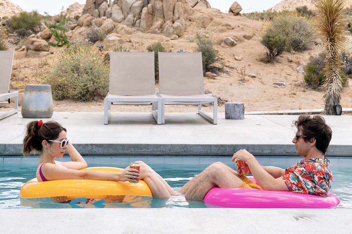 Cristin Milioti and Andy Samberg floating on pool floats.
