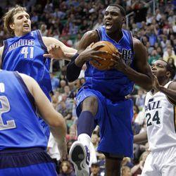 Dallas Mavericks center Ian Mahinmi (28) screams as he rebound the ball as the Utah Jazz and the Dallas Mavericks play Monday, April 16, 2012 in Salt Lake City.