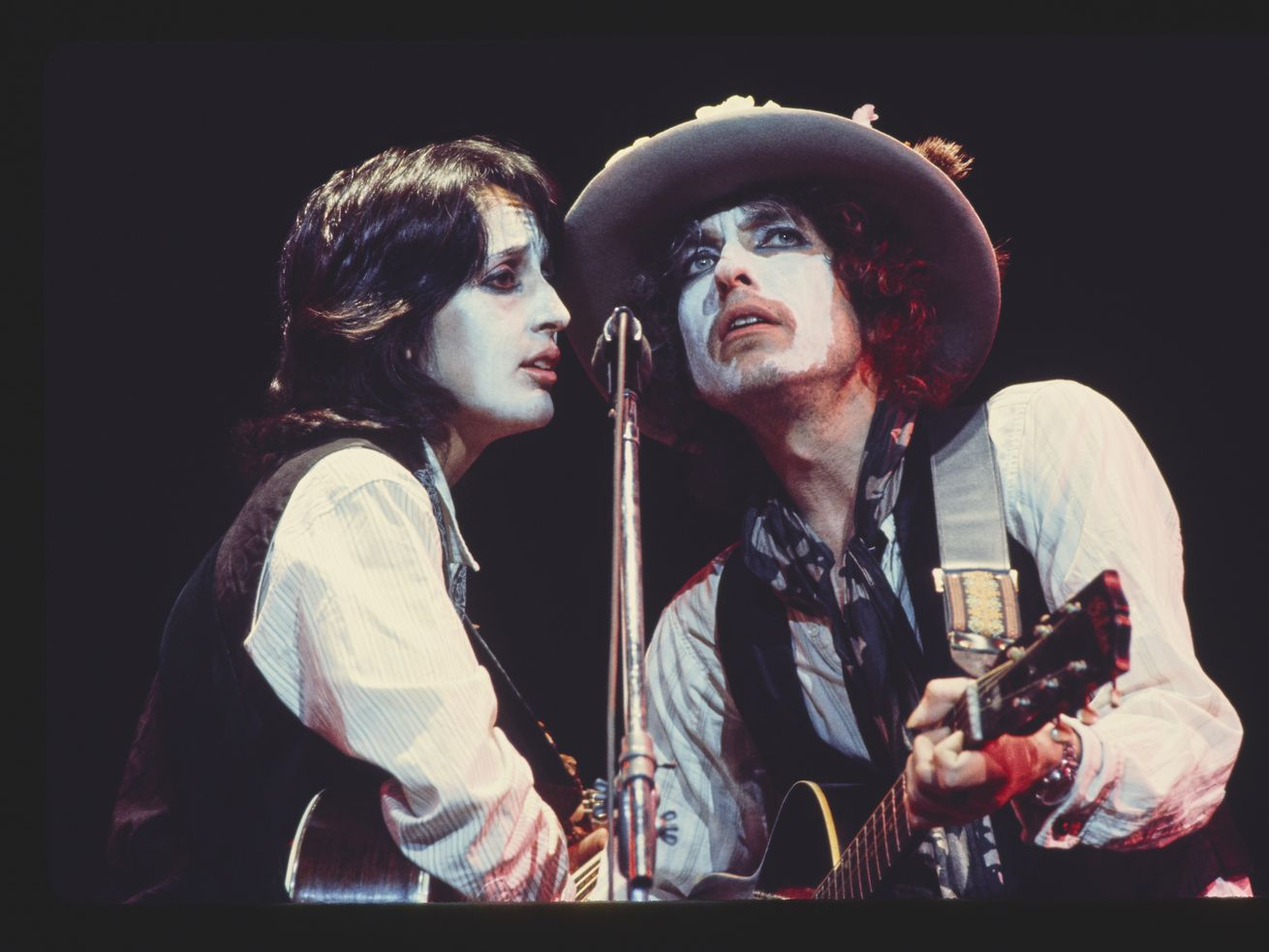 "Joan Baez shares the microphone with Bob Dylan during the 1975 tour documented in ""Rolling Thunder Revue."""
