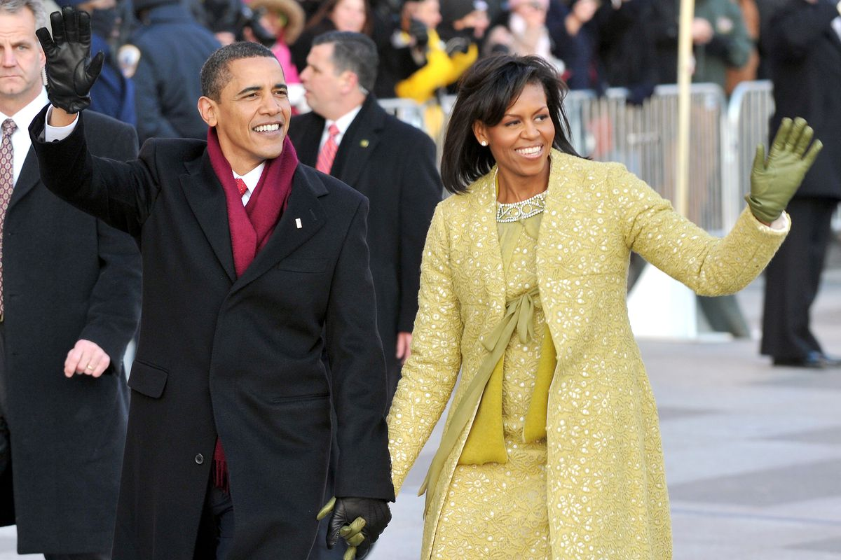 Michelle and Barack Obama wave during the 2009 inauguration parade