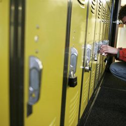 Eric Richardson unlocks one of two free lockers he uses on campus to store food and books.