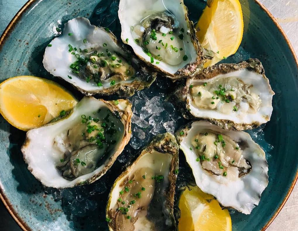Oysters with lemon at Fox and Grapes restaurant in Wimbledon, London