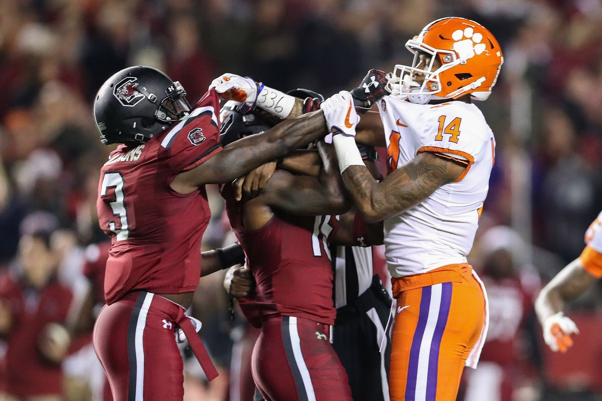 Nov 25, 2017; Columbia, SC, USA; Clemson Tigers wide receiver Diondre Overton (14) fights with South Carolina Gamecocks defensive back Chris Lammons (3) during the second half at Williams-Brice Stadium. Mandatory Credit: Jim Dedmon-USA TODAY Sports