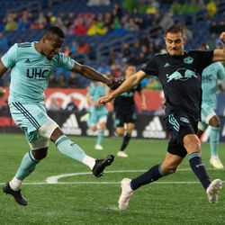 FOXBOROUGH, MA - APRIL 20: New England Revolution forward Cristian Penilla #70 fires a shot by New York Red Bulls defender Aaron Long #33 to score the game's only goal at Gillette Stadium on April 20, 2019 in Foxborough, Massachusetts. (Photo by J. Alexander Dolan - The Bent Musket)