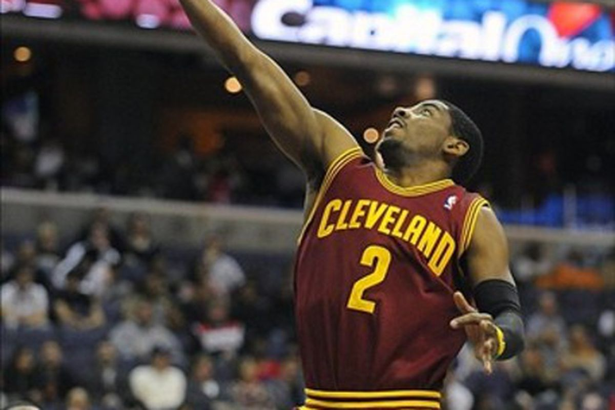 Mar 3, 2012; Washington, DC, USA; Cleveland Cavaliers point guard Kyrie Irving (2) shoots a layup during the second half at the Verizon Center. The Wizards defeated the Cavaliers 101 - 98. Mandatory Credit: Brad Mills-US PRESSWIRE