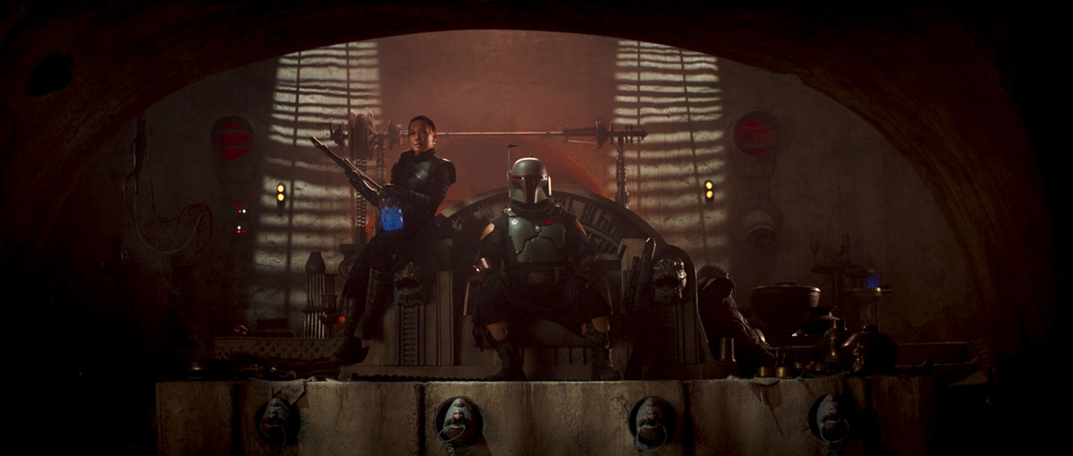 Boba Fett and Fennec Shand sit on the Jabba's Palace throne in The Mandalorian season 2