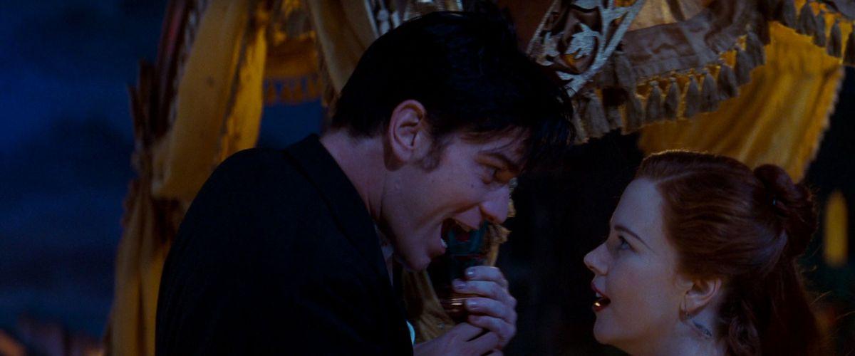 Ewan McGregor looms over Nicole Kidman, hard-sell singing love songs at her in Moulin Rouge