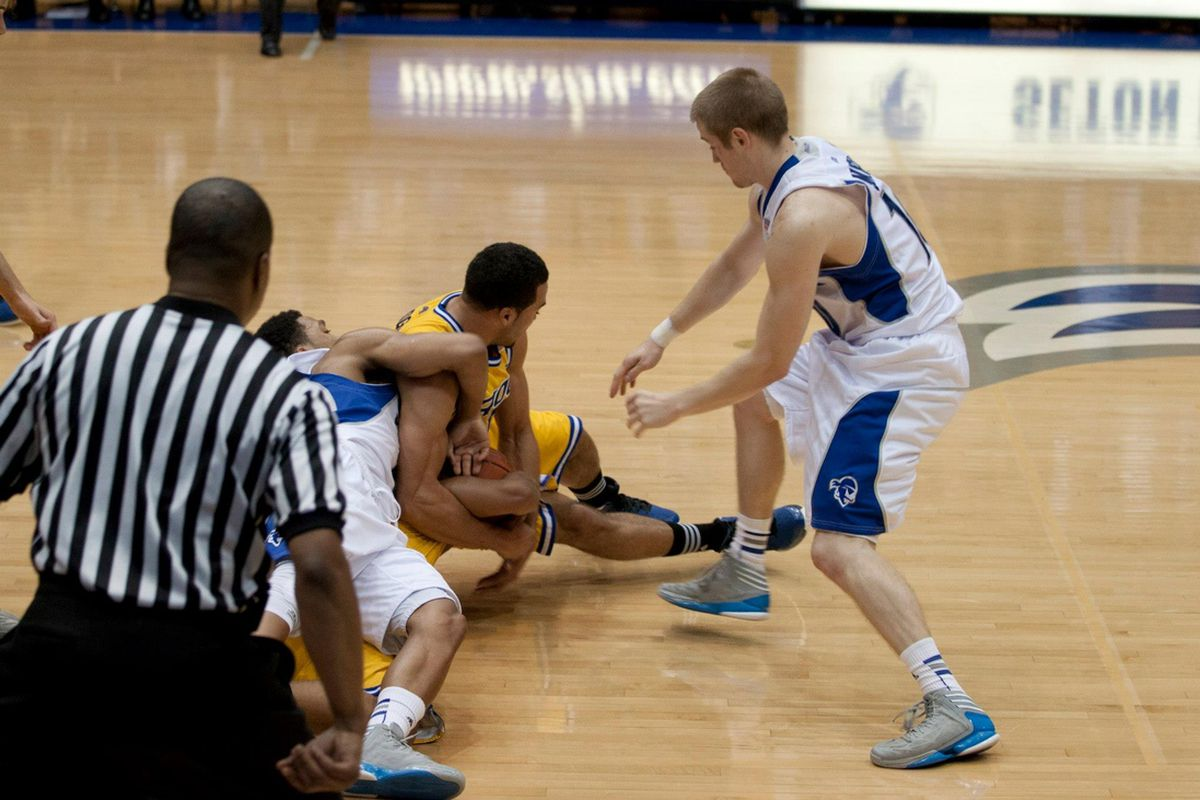 Tom Maayan and Kyle Smyth battle for a loose ball in Friday's opener.