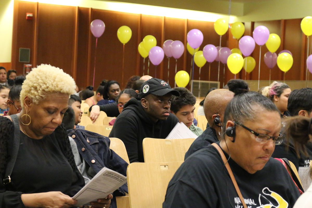 The New Settlement Parent Action committee tied balloons to empty auditorium seats to represent District 9 students who go without social workers.