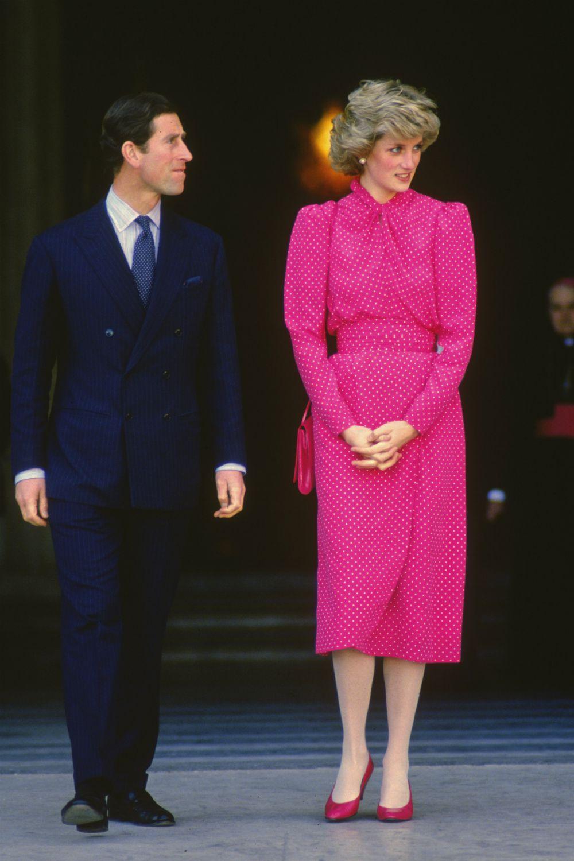 Princess Di n a pink dress with Charles