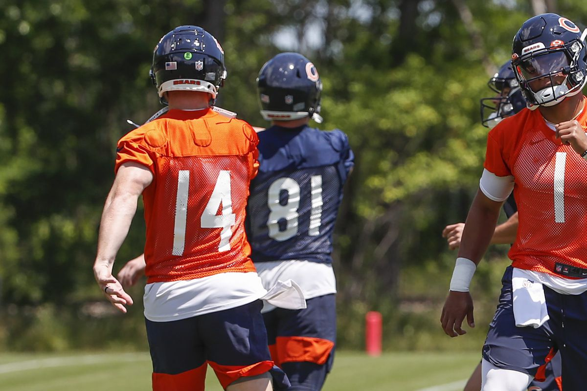 Justin Fields (1) will try to take the Bears' starting quarterback job from Andy Dalton (14).