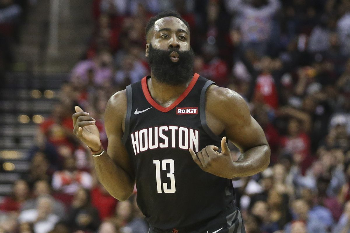 Houston Rockets guard James Harden plays air guitar after he made a three point basket against the Portland Trail Blazers in the second quarter at Toyota Center.