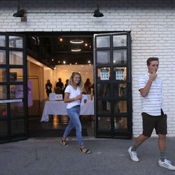 Addy Larsen and Wyatt Davies leave the State House after attending the Synesthesia art show, organized by Ella Ballstaedt, in Orem on Friday, June 12, 2020.