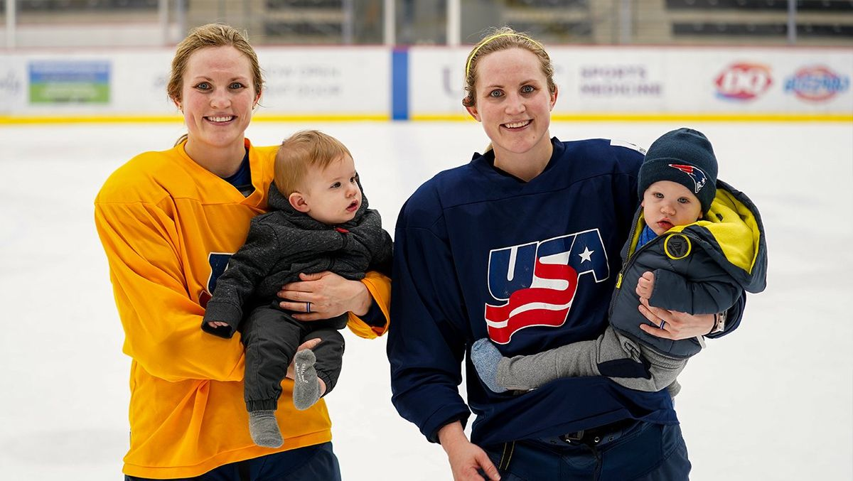 Jocelyne Lamoureux-Davidson (left) and Monique Lamoureux-Morando (right) on the ice with their sons, Nelson and Mickey.
