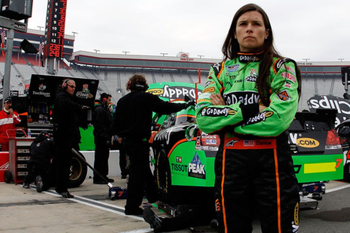 Danica Patrick stands in the garage area during practice for the NASCAR Nationwide Series Scotts EZ Seed 300 at Bristol Motor Speedway.