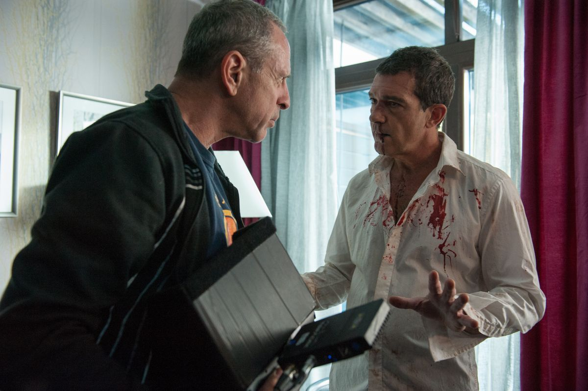 Florentine gives notes to Antonio Banderas on the set of Acts of Vengeance