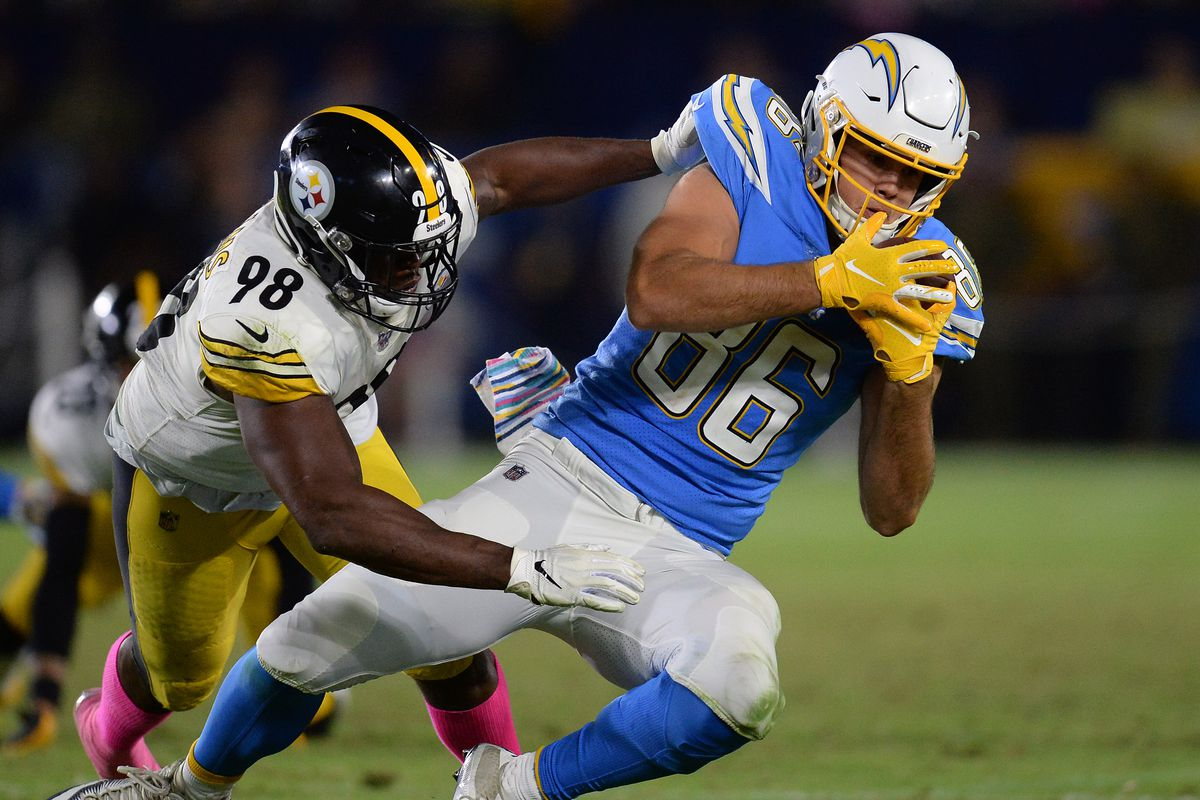 Los Angeles Chargers tight end Hunter Henry catches a pass against the defense of Pittsburgh Steelers cornerback Mike Hilton during the second half at Dignity Health Sports Park.