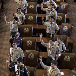 Boy Scouts recite the Scout Oath during the annual Boy Scouts Parade and Report to State in the House Chambers at the Texas capitol, in Austin, Texas.