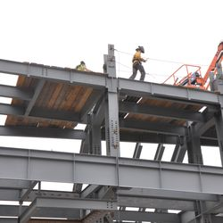 Boards being used to create a work platform on the left-field scoreboard structure -
