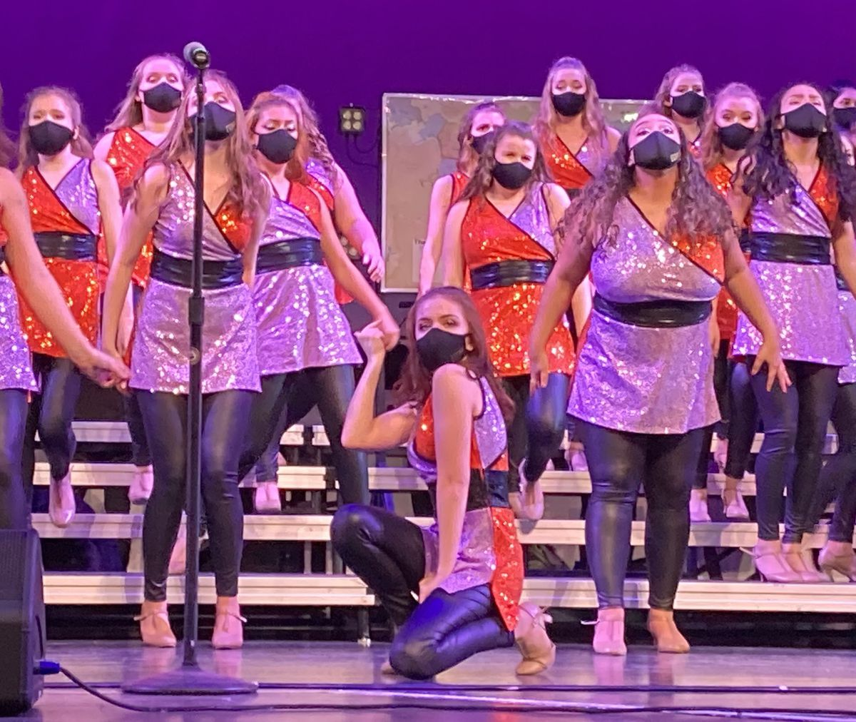 Avon High School's all-girls show choir competed during the pandemic wearing matching masks.