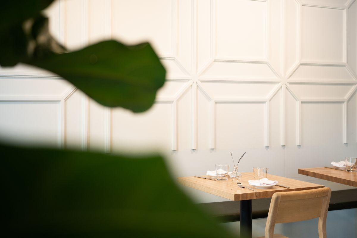 The white molded tile walls and wood tables at Eight Row.