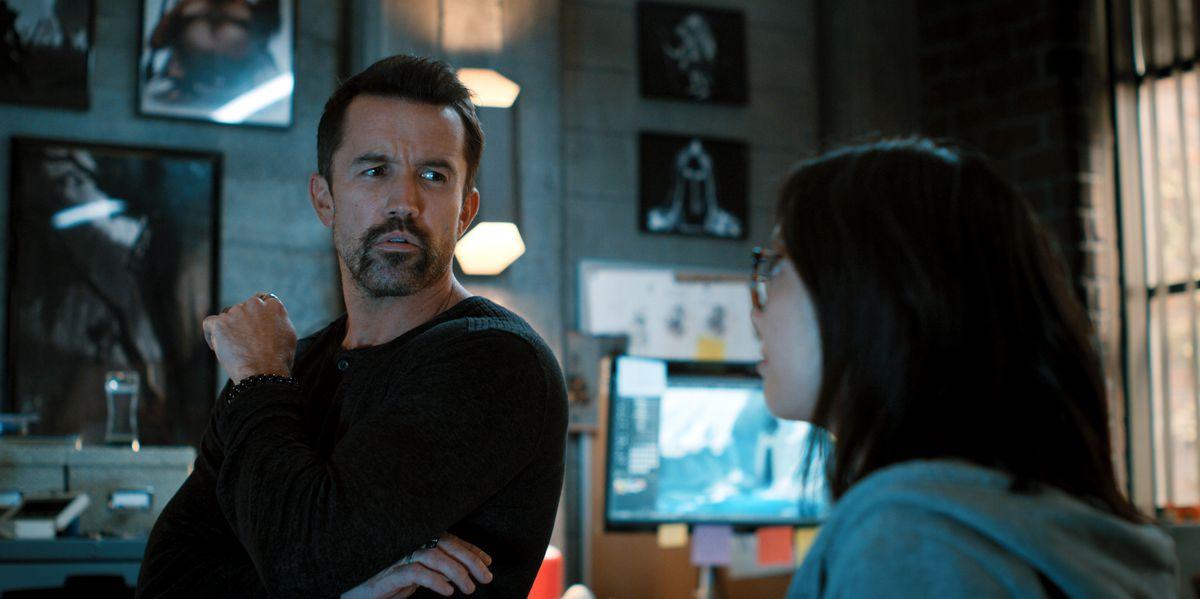 Ian Grimm has a conversation with Poppy Li in Mythic Quest season 2.