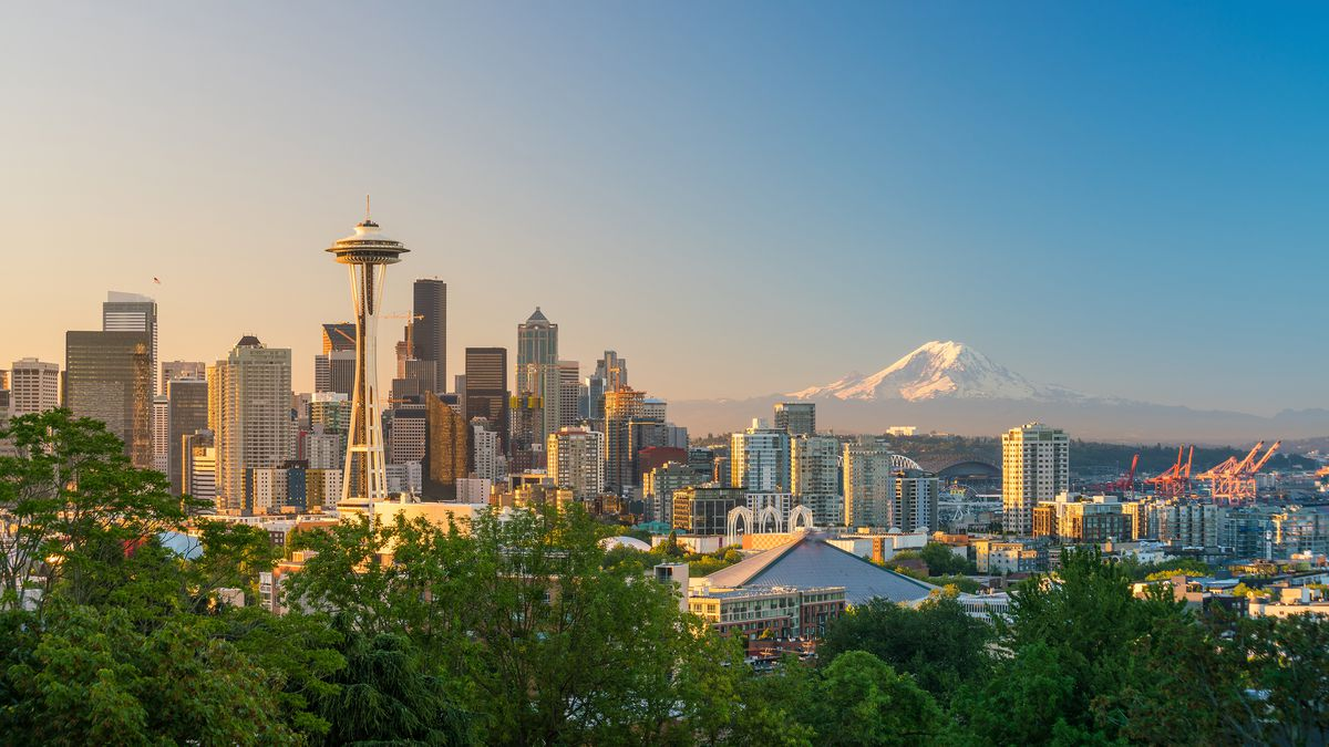 The Seattle skyline with the Space Needle seen to the left and Mount Rainier in the distance to the right