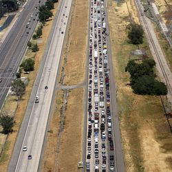 Northbound traffic is backed up on I-15 after a fatal plane crash shut down northbound I-15 in Riverdale on Wednesday, July 26, 2017. All four people on board died.