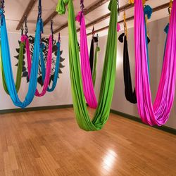 """<b>Aerial Yoga at <a href=""""http://www.kayaaerialyogaphiladelphia.com/?page_id=64"""">Kaya Aerial Yoga</a></b><br> Channel your inner Cirque du Soleil performer with an aerial yoga class at Old City's Kaya Aerial Yoga. Depending on your personal level of coo"""