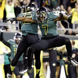 Oregon's Keanon Lowe, right, and Daryle Hawkins celebrate Hawkins touchdown during the first half of their NCAA college football game against Arizona in Eugene, Ore., Saturday, Sept. 22, 2012. (AP Photo/Don Ryan)