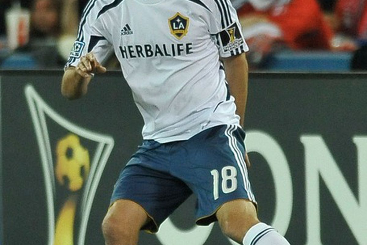 TORONTO, CANADA - MARCH 7:  Mike Magee #18 of the Los Angeles Galaxy runs with the ball during CONCACAF Champions League game action against the Toronto FC March 7, 2012 at the Rogers Centre in Toronto, Canada (Photo by Brad White/Getty Images)