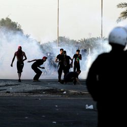 Bahraini anti-government protesters clash with riot police in Sadad, Bahrain, on Saturday, Sept. 29, 2012, after the politically charged funeral for Ali Hussein Niema, 17, who allegedly was shot dead by riot police late Friday. The death could bring fresh protests by Shiite-led groups seeking a greater political voice in the Sunni-ruled Gulf kingdom.