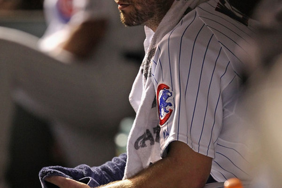 Starting pitcher Randy Wells of the Chicago Cubs watches from the dugout as his teammates bat against the Atlanta Braves at Wrigley Field in Chicago, Illinois. The Cubs defeated the Braves 3-2. (Photo by Jonathan Daniel/Getty Images)