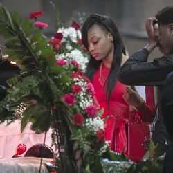 """LaTonya Jones (center) attends the funeral services for her mother, Bettie Jones, who was """"accidentally"""" shot by a Chicago Police officer the day after Christmas, at New Mount Pilgrim Missionary Baptist Church on Wednesday, Jan. 6, 2016."""