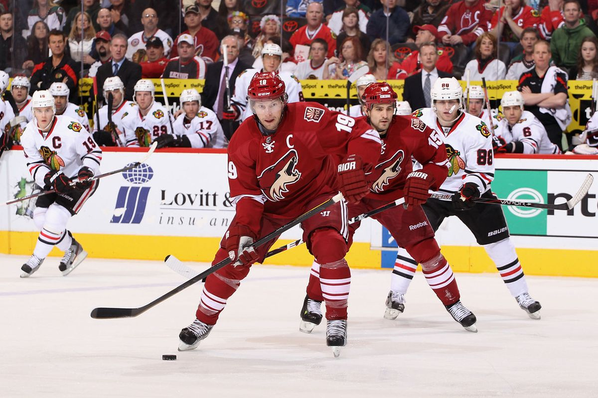 GLENDALE, AZ - FEBRUARY 11:  Shane Doan #19 of the Phoenix Coyotes skates with the puck during the NHL game against the Chicago Blackhawks at Jobing.com Arena on February 11, 2012 in Glendale, Arizona.  (Photo by Christian Petersen/Getty Images)