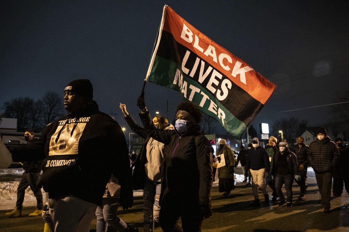 Dozens of Black Lives Matter protesters march around Kenosha after District Attorney Michael Graveley announced that no charges will be filed against the Kenosha police officer who shot Jacob Blake, Tuesday night, Jan. 5, 2021.