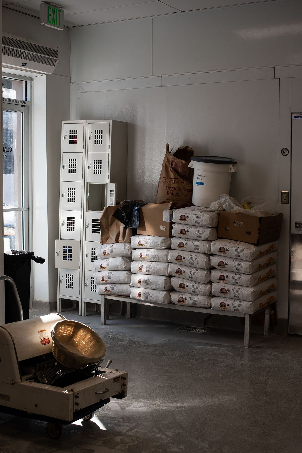 Stacked flour at a new bakery as sun streams in.