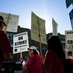 """Public school teachers picket outside Amundsen High School in Chicago on the first day of a strike by the Chicago Teachers Union, Monday, Sept. 10, 2012. The school is one of more than 140 schools in the Chicago Public Schools' """"Children First"""" contingency plan, which feeds and houses students for four hours during the strike."""
