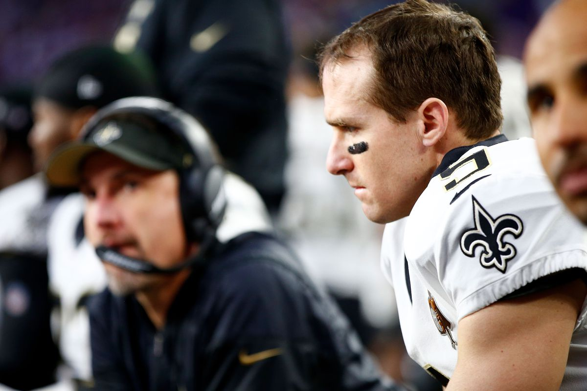 MINNEAPOLIS, MN - New Orleans Saints quarterback Drew Brees (9) watches the Minnesota Vikings offense drive against defensive coordinator Dennis Allen's (left) unit from the sideline during the NFC Divisional Round playoff game at U.S. Bank Stadium.