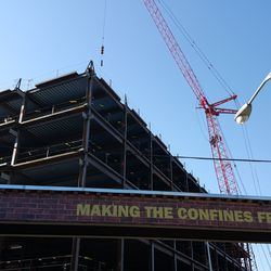 10:39 a.m. Crane lifting steel to the top of the plaza building -