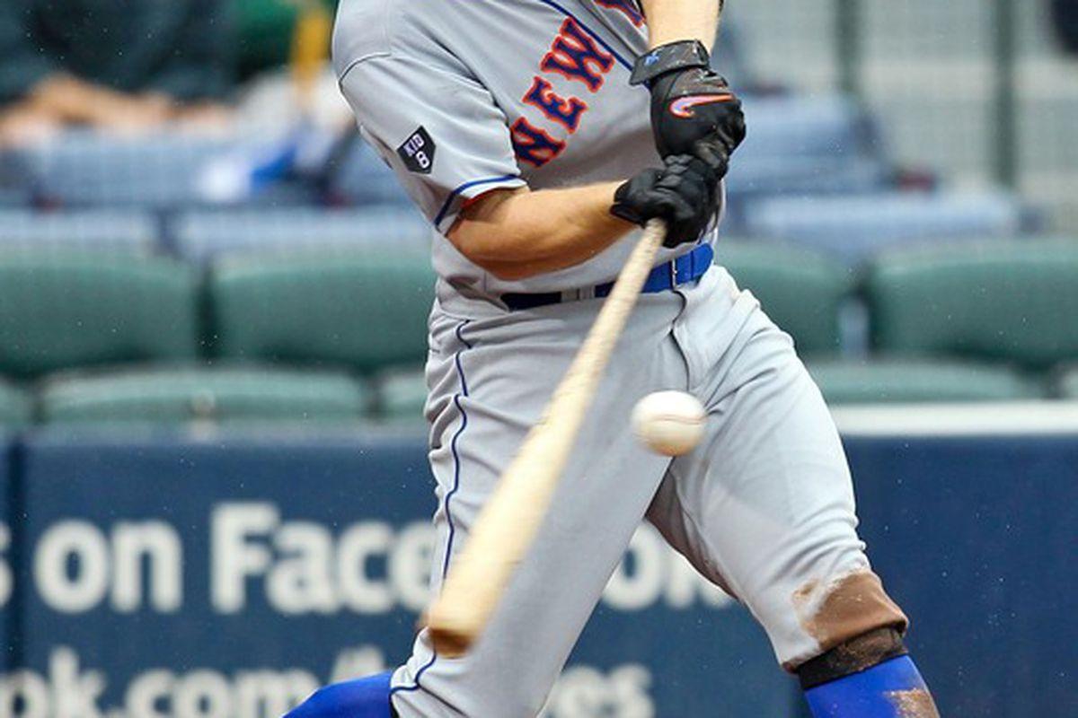 April 18, 2012; Atlanta, GA, USA; New York Mets third baseman David Wright (5) drives in a run in the fifth inning against the Atlanta Braves at Turner Field. Mandatory Credit: Daniel Shirey-US PRESSWIRE