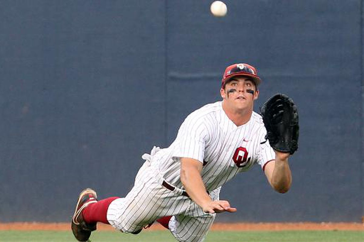 """Oklahoma's Max White hit his first home run of the 2012 season in the Sooners 7-0 win over Alabama State on Sunday. Photo via <a href=""""http://i.usatoday.net/sports/gallery/2010/college-world-series/OklaDivingpg-horizontal.jpg"""">i.usatoday.net</a>"""