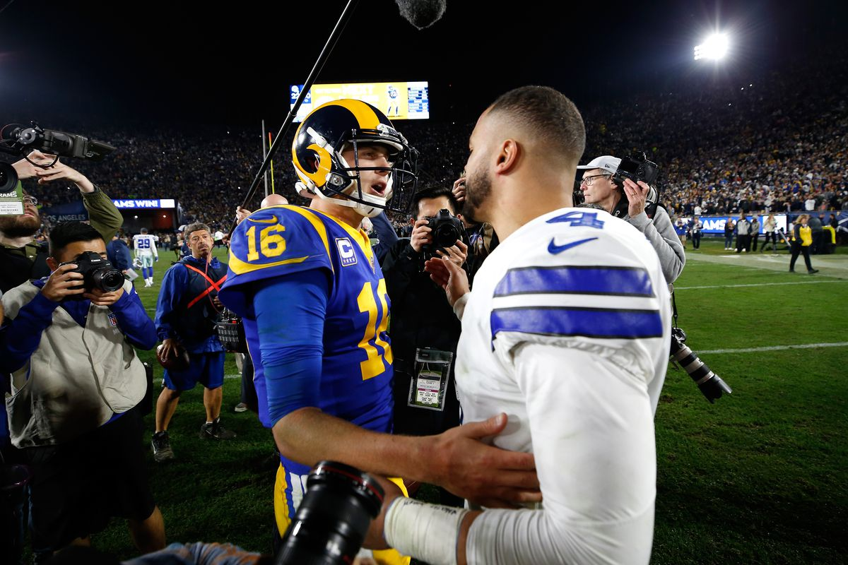 Jared Goff of the Los Angeles Rams and Dak Prescott of the Dallas Cowboys speak after the NFC Divisional Playoff game at Los Angeles Memorial Coliseum on January 12, 2019 in Los Angeles, California.