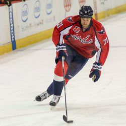 Laich Skates With Puck