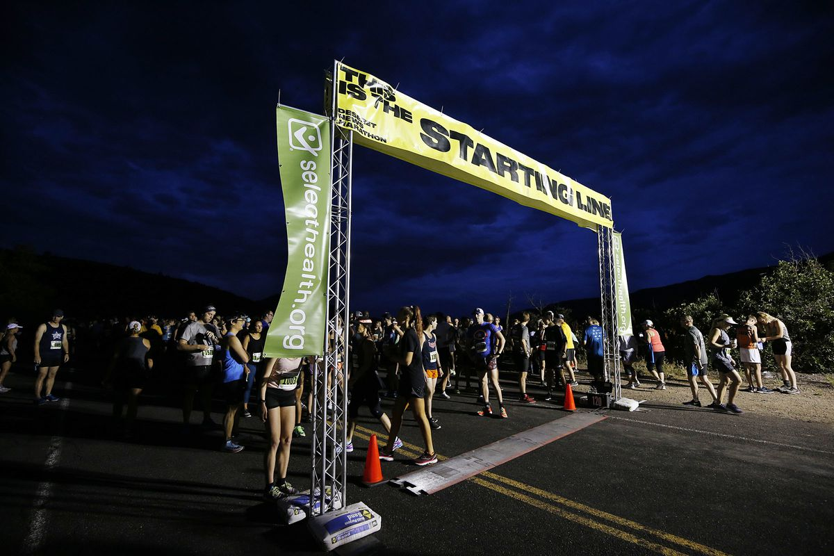 Runners gather for the start of the Deseret News half marathon on Wednesday, July 24, 2019, in Salt Lake City.