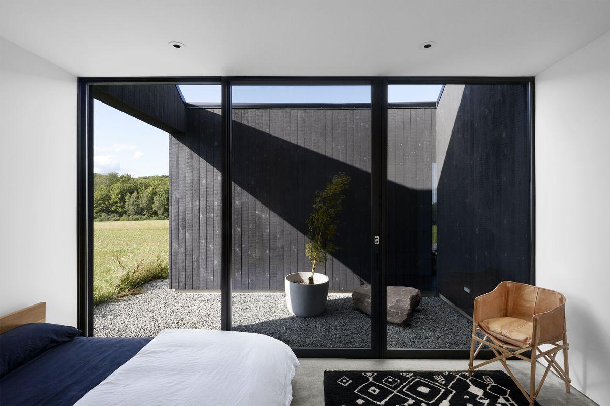 Bedroom opening onto private garden.