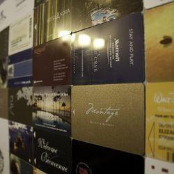 Key cards from Elizabeth Blau and Kim Canteenwalla's travels line the women's bathroom walls.