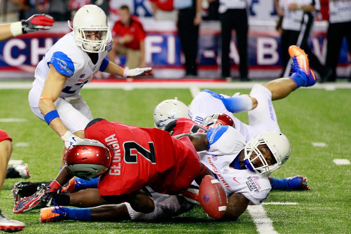 ATLANTA, GA - SEPTEMBER 03:  Dextrell Simmons #6 of the Boise State Broncos forces a fumble on a kickoff by Brandon Boykin #2 of the Georgia Bulldogs at Georgia Dome on September 3, 2011 in Atlanta, Georgia.  (Photo by Kevin C. Cox/Getty Images)